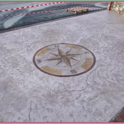 Disegno loghi personalizzati su cemento a Piacenza per pavimentazioni