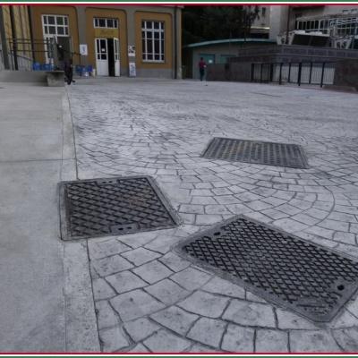 Pavimento in cemento stampato e tombini stradali a Lodi