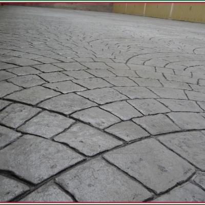 Cemento stampato effetto porfido per cortile auto