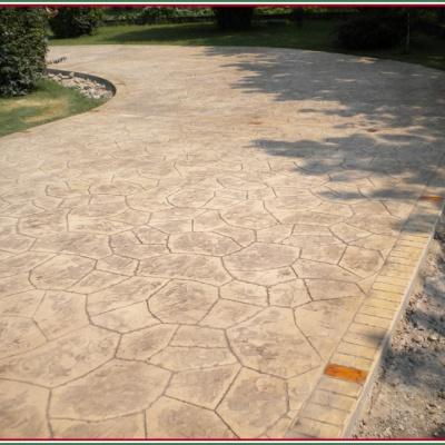 Viale per abitazione carrabile in cemento effetto sasso irregolare
