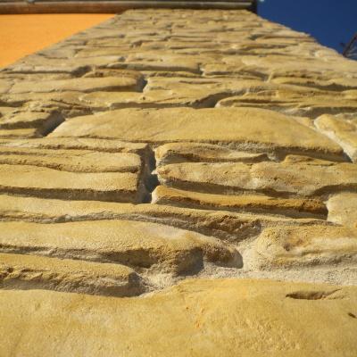 Rivestimenti esterni in intonaco stampato effetto pietra a Piacenza
