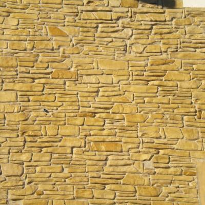 Effetto pietra di fiume con intonaco stampato per rivestimenti