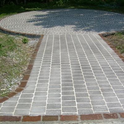 Piazza giardinetti a Crema in cemento effetto pietra senza fughe